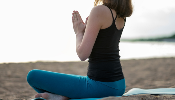 yoga pose with folded hands